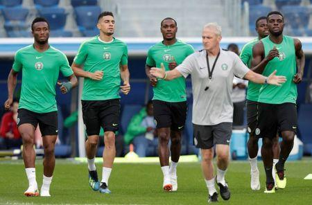 Soccer Football - World Cup - Nigeria Training - Saint Petersburg Stadium, St. Petersburg, Russia - June 25, 2018. Nigeria's coach Gernot Rohr, players Mikel John Obi, Leon Balogun, Odion Ighalo and John Ogu during training. REUTERS/Henry Romero