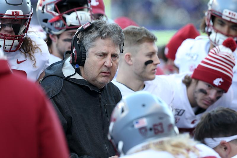 SEATTLE, WA - NOVEMBER 29: Washington State head coach Mike Leach huddles with his offensive unit on the sidelines during the college football game between the Washington Huskies and the Washington State Cougars on November 29, 2019 at Husky Stadium in Seattle, WA. (Photo by Jesse Beals/Icon Sportswire via Getty Images)