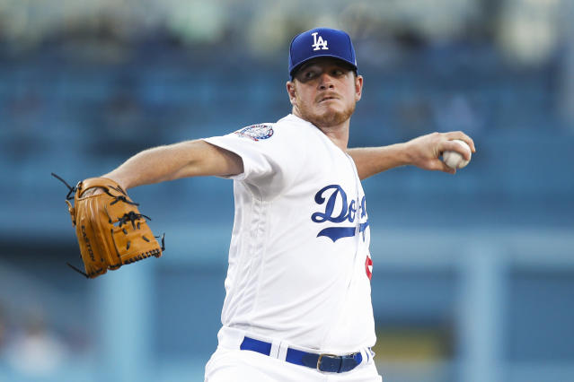 Los Angeles starting pitcher Caleb Ferguson throws to a Texas Rangers batter during the first inning of a baseball game Tuesday, June 12, 2018, in Los Angeles. (AP Photo/Jae C. Hong)