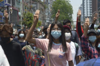 Anti-coup protesters flash the three-finger sign of defiance during a demonstration in Yangon, Myanmar, on Friday, April 23, 2021. Leaders of the 10-member Association of Southeast Asian Nations meet Saturday, April 24, in Jakarta to consider plans to promote a peaceful resolution of the conflict that has wracked Myanmar since its military launched a deadly crackdown on opponents to its seizure of power in February. (AP Photo)