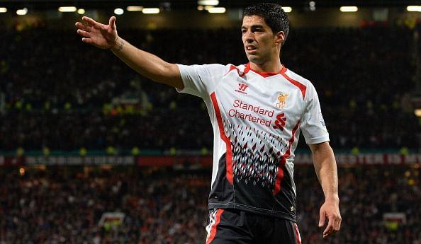 Luis Suarez in action for Liverpool against Manchester United