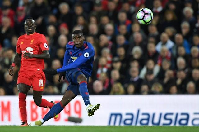 Manchester United midfielder Paul Pogba (right) in action against Liverpool at Anfield on October 17, 2016 (AFP Photo/Paul Ellis)