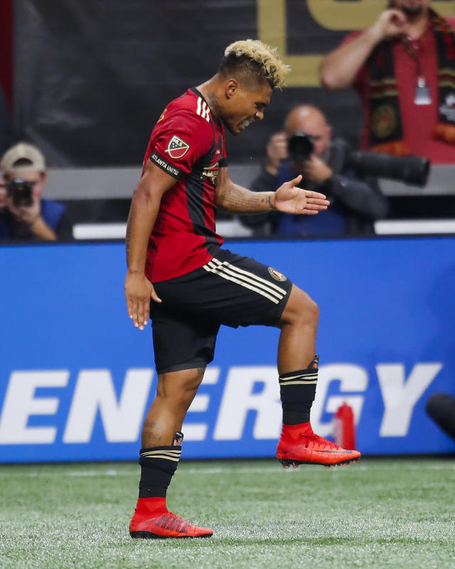 Atlanta United forward Josef Martinez (7) reacts after scoring a goal in the first half of an MLS soccer game against D.C. United, Sunday, March 11, 2018, in Atlanta. (AP Photo/Todd Kirkland)