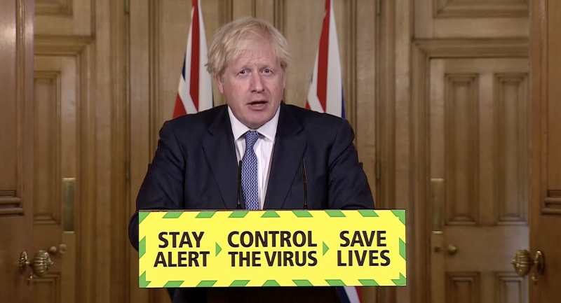 UK's Johnson hits the brakes after 'warning light' of spike in cases