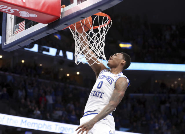 Memphis' D. J. Jeffries (0) dunks a basket in the second half of an NCAA college basketball game against Mississippi, Saturday, Nov. 23, 2019, in Memphis, Tenn. (AP Photo/Karen Pulfer Focht)