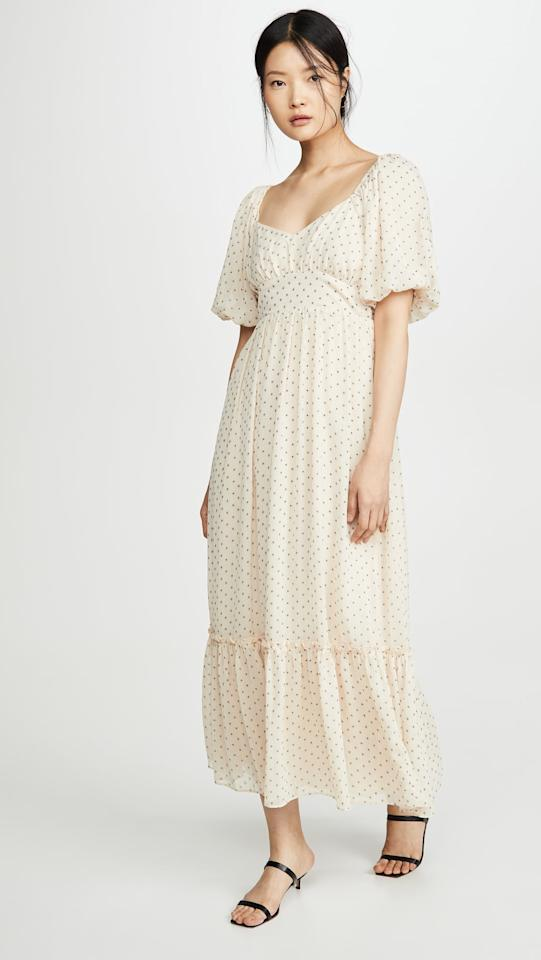 """<p>This versatile <a href=""""https://www.popsugar.com/buy/ENGLISH-FACTORY-Empire-Maxi-Puff-Sleeve-Dress-552313?p_name=ENGLISH%20FACTORY%20Empire%20Maxi%20Puff%20Sleeve%20Dress&retailer=shopbop.com&pid=552313&price=100&evar1=savvy%3Aus&evar9=47261534&evar98=https%3A%2F%2Fwww.popsugar.com%2Fphoto-gallery%2F47261534%2Fimage%2F47262035%2FENGLISH-FACTORY-Empire-Maxi-Puff-Sleeve-Dress&list1=shopping%2Ctravel%2Ceditors%20pick%2Ctravel%20tips%2Ctravel%20style&prop13=api&pdata=1"""" rel=""""nofollow"""" data-shoppable-link=""""1"""" target=""""_blank"""" class=""""ga-track"""" data-ga-category=""""Related"""" data-ga-label=""""https://www.shopbop.com/empire-maxi-puff-sleeve-dress/vp/v=1/1558316421.htm?colorId=12688"""" data-ga-action=""""In-Line Links"""">ENGLISH FACTORY Empire Maxi Puff Sleeve Dress</a> ($100) is the perfect piece to wear with sneakers in the day and cute heals by night.</p>"""