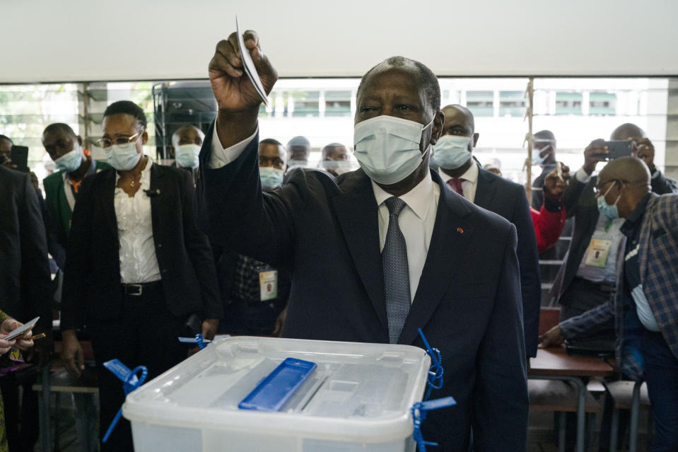Ivory Coast President Alassane Ouattara casts his vote at a polling station during presidential elections in Abidjan, Ivory Coast, Saturday, Oct. 31, 2020. Tens of thousands of security forces deployed across Ivory Coast on Saturday as the leading opposition parties boycotted the election, calling President Ouattara's bid for a third term illegal. (AP Photo/Leo Correa)