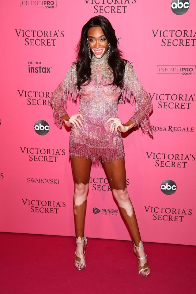 <p>In a sheer pink mini with crystal fringe.</p>