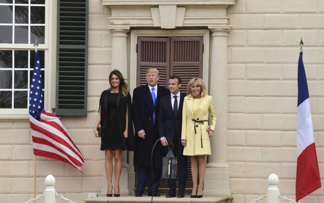 First lady Melania Trump, left, President Donald Trump, second from left, French President Emmanuel Macron, second from right, and his wife Brigitte Macron, right, pose for a photo during a visit and private dinner at George Washington's Mount Vernon estate in Mount Vernon, Va., Monday, April 23, 2018. (AP Photo/Susan Walsh)