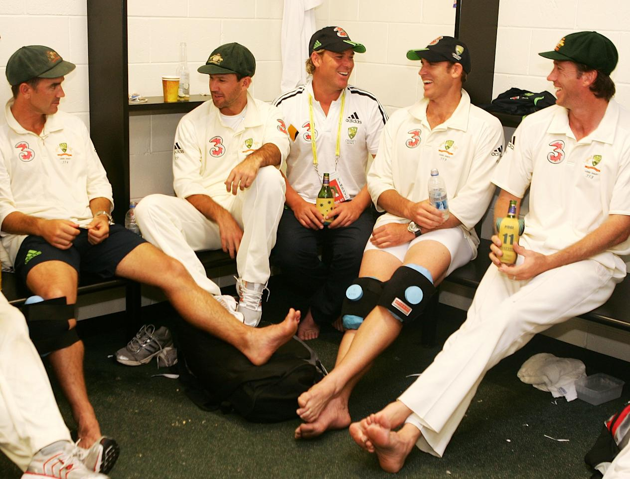 BRISBANE, AUSTRALIA - NOVEMBER 27:  (L-R) Justin Langer, Ricky Ponting, Shane Warne, Matthew Hayden and Glenn McGrath of Australia celebrate in the changing rooms after Australia's victory on day five of the first Ashes Test Match between Australia and England at The Gabba on November 27, 2006 in Brisbane, Australia.  (Photo by Hamish Blair/Getty Images)