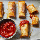 <p>These cheesy baked pizza rolls with marinara dipping sauce would be fun for a casual party for kids or adults--or just for dinner! Classic pizza fillings are tucked into egg roll wrappers, which are baked--no frying required!--until nice and crispy on the outside. Feel free to mix up the fillings; for example, you could drop the pepperoni to make these vegetarian or nix the mushrooms if you're not a fan.</p>