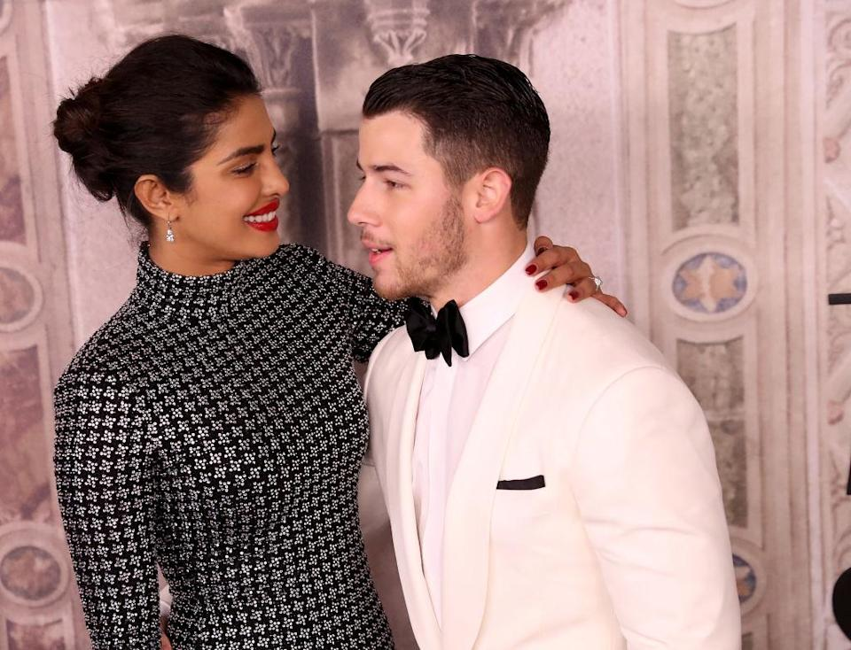 <p>Priyanka Chopra and Nick Jonas attend the Ralph Lauren 50th anniversary show during New York Fashion Week at Bethesda Terrace on September 7, 2018 in New York City. (Photo: Rob Kim/Getty Images) </p>