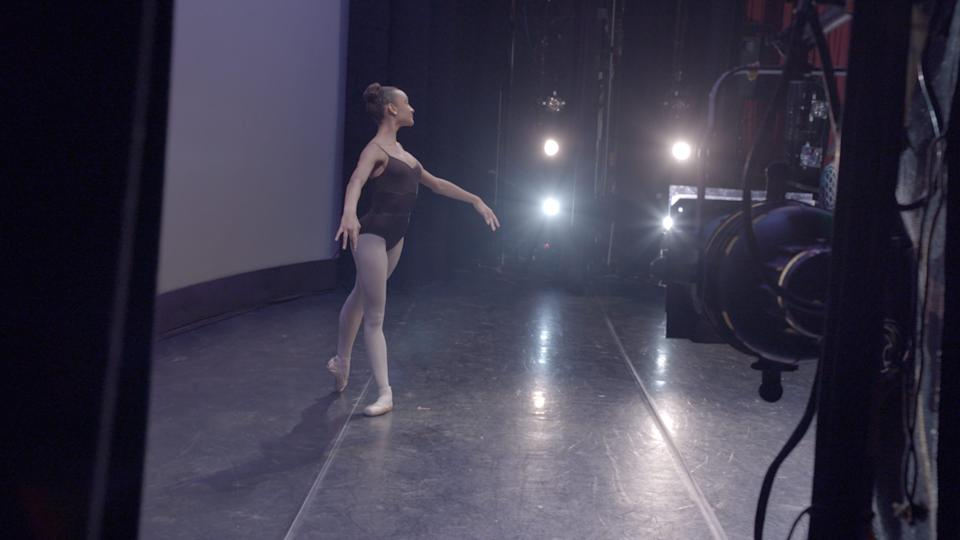 "A young dancer onstage at the School of American Ballet in Disney+'s ""On Pointe."""