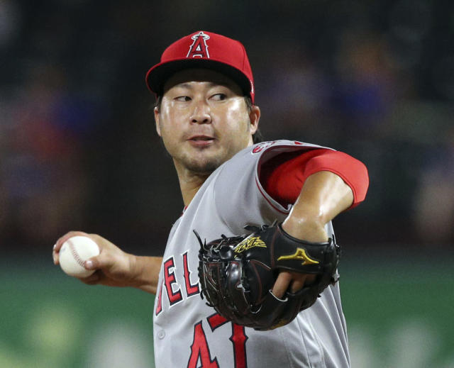 FILE - In this Tuesday, Sept. 4, 2018 file photo, Los Angeles Angels relief pitcher Junichi Tazawa (47) works the seventh inning against the Texas Rangers in a baseball game in Arlington, Texas. Reliever Junichi Tazawa has finalized a minor league contract with the Chicago Cubs and will report to big league spring training. If added to the 40-man roster, Tazawa would receive a one-year contract paying $800,000 while in the major leagues. He could earn $450,000 in performance bonuses for games pitched and $750,000 for games finished. The 32-year-old right-hander was with a 7.07 ERA in 31 games last season for Miami and the Los Angeles Angels. (AP Photo/Richard W. Rodriguez, File)