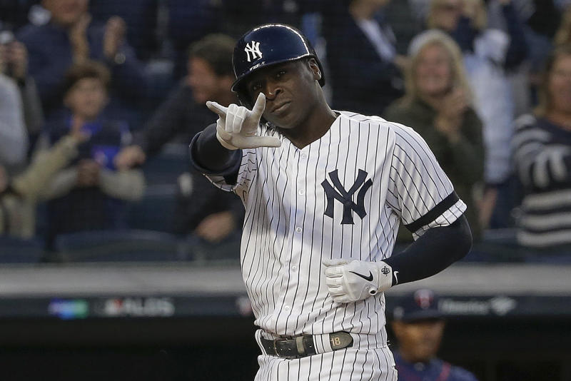 New York Yankees' Didi Gregorius motions as he crosses the plate after hitting a grand slam home run against the Minnesota Twins during the third inning of Game 2 of an American League Division Series baseball game, Saturday, Oct. 5, 2019, in New York. (AP Photo/Seth Wenig)