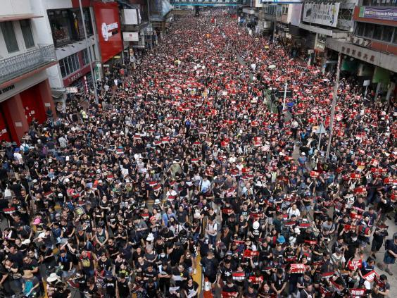 Protesters line the streets demanding Hong Kong's leaders withdraw the extradition bill (REUTERS)