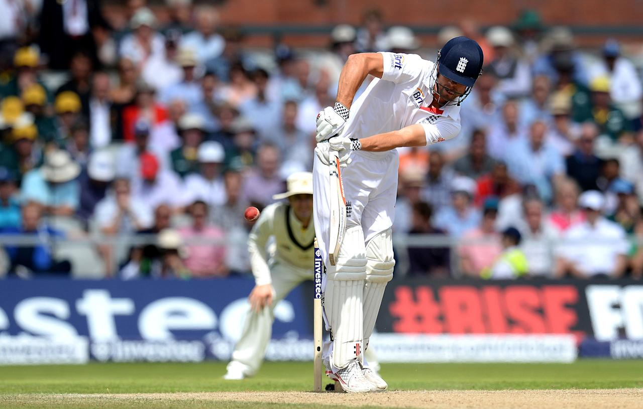 Alastair Cook edges a ball from Australia's Mitchell Starc to wicket keeper Brad Haddin as he is out for 62, during day three of the Third Investec Ashes test match at Old Trafford Cricket Ground, Manchester.