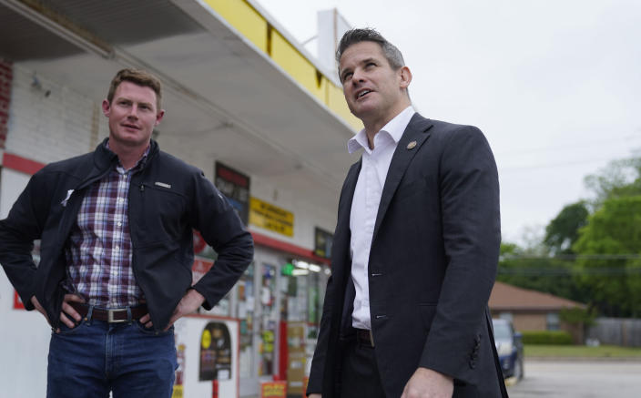 Rep. Adam Kinzinger, R-Ill., right, stands with Texas congressional candidate Michael Wood after they met for lunch, Tuesday, April 27, 2021, in Arlington, Texas. Wood is considered the anti-Trump Republican Texas congressional candidate that Kinzinger has endorsed in the May 1st special election for the 6th Congressional District. (AP Photo/LM Otero)