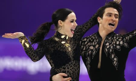 Figure Skating - Pyeongchang 2018 Winter Olympics - Ice Dance short dance competition - Gangneung Ice Arena - Gangneung, South Korea - February 19, 2018 - Tessa Virtue and Scott Moir of Canada perform. REUTERS/Phil Noble