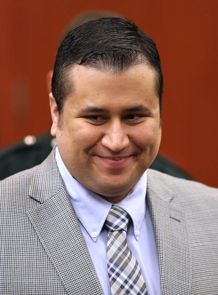 George Zimmerman smiles during a recess during his trial in Seminole circuit court in Sanford, Fla., Monday, June 17, 2013. Zimmerman has been charged with second-degree murder for the 2012 shooting death of Trayvon Martin.(AP Photo/Orlando Sentinel, Joe Burbank, Pool)