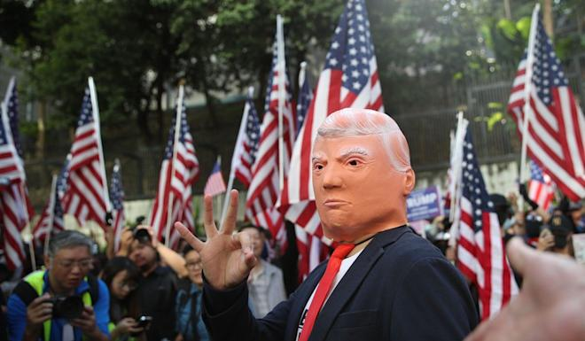 Anti-government protesters at a rally to thank US President Donald Trump for signing the Hong Kong Human Rights and Democracy Act into law. Photo: Winson Wong