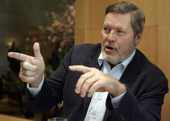 """FILE - In this May 1, 2007, file photo, John Langley, creator of television's """"Cops,"""" gestures during an interview in New York. Langley has died during a road race in Mexico, a family spokeswoman said. Langley died in Baja, Mexico, of an apparent heart attack Saturday, June 26, 2021, during the Coast to Coast Ensenada-San Felipe 250 off-road race, family spokeswoman Pam Golum said. He was 78. (AP Photo/Richard Drew, File)"""