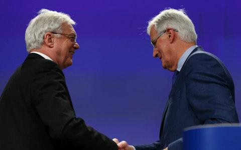 United Kingdom's Secretary of State for Exiting the European Union, David Davis (L) and European Chief Negotiator for Brexit, Michel Barnier
