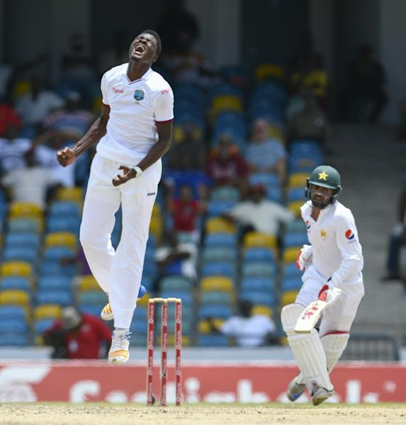 Alzarri Joseph (L) of West Indies disappointed Ahmed Shehzad (R) of Pakistan was dropped during the 5th and final day of their 2nd Test match at Kensington Oval, Bridgetown, Barbados, May 04, 2017