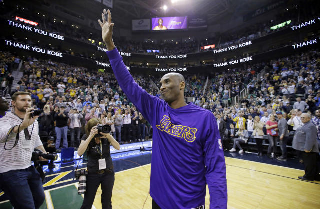 FILE - In this March 28, 2016, file photo, Los Angeles Lakers forward Kobe Bryant waves to the fans after his introduction before the start of the first quarter of an NBA basketball game against the Utah Jazz, in Salt Lake City. Bryant, the 18-time NBA All-Star who won five championships and became one of the greatest basketball players of his generation during a 20-year career with the Los Angeles Lakers, died in a helicopter crash Sunday, Jan. 26, 2020. He was 41. (AP Photo/Rick Bowmer, File)