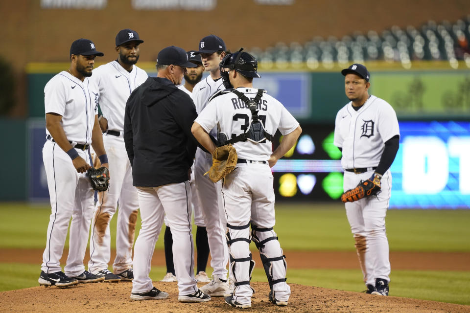 Detroit Tigers manager A.J. Hinch confers with starting pitcher Casey Mize during the sixth inning of a baseball game against the Kansas City Royals, Wednesday, May 12, 2021, in Detroit. (AP Photo/Carlos Osorio)