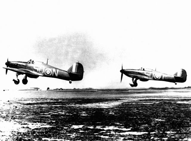 Two RAF Hawker Hurricane MK1 fighters from RAF 79 Squadron taking off from RAF Hawkinge, Kent during the Battle of Britain (PA)