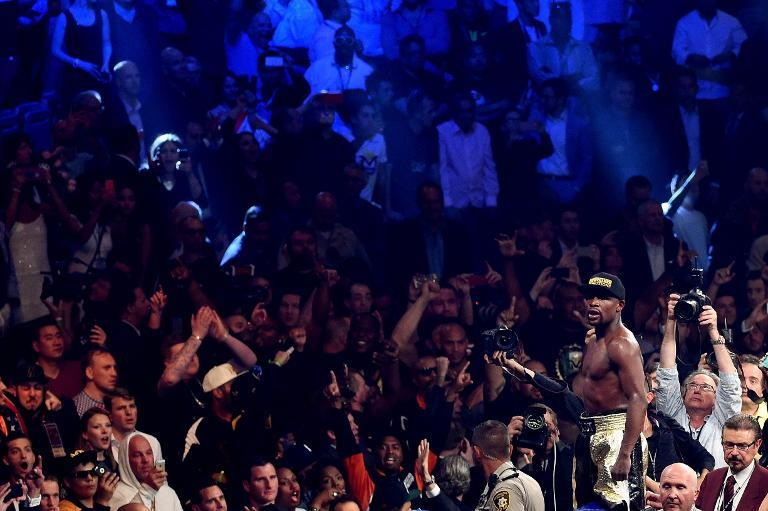 The crowd take smartphone photos of Floyd Mayweather as he celebrates his unanimous decision victory against Manny Pacquiao on May 2, 2015 at the MGM Grand Garden Arena