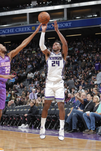 SACRAMENTO, CA - MARCH 23: Buddy Hield #24 of the Sacramento Kings shoots the ball during the game against Mikal Bridges #25 of the Phoenix Suns on March 23, 2019 at Golden 1 Center in Sacramento, California. (Photo by Rocky Widner/NBAE via Getty Images)