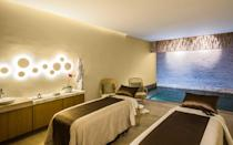 """<p>The <a rel=""""nofollow noopener"""" href=""""http://velasresorts.com/"""" target=""""_blank"""" data-ylk=""""slk:luxury resorts Grand Velas"""" class=""""link rapid-noclick-resp"""">luxury resorts Grand Velas</a> Riviera Nayarit, Casa Velas and the new Grand Velas Los Cabos each have dedicated Wellness Suites with in-room exercise kits so you have your own yoga mat, dumbbells, resistance bands, and an exercise bike. The rooms also have Alchimia Apothecary Aromatherapy Kits with scents ranging from cedar and lavender to tangerine and myrrh so you can relax at night.</p> <p>The resorts feature healthy menus and a minibar with carrots, cucumber, jicama, celery, beetroot and pineapple. Rooms also come with a Vitamin C Sprinkler that lightly spritzes guests on command with a warm bath of vitamin C essential oils.</p>"""