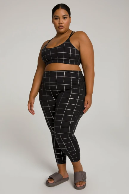 """<br><br><strong>Good American</strong> Foil Tux 7/8 Legging, $, available at <a href=""""https://go.skimresources.com/?id=30283X879131&url=https%3A%2F%2Fwww.goodamerican.com%2Fproducts%2Ffoil-tux-7-8-legging-graphic-plaid002"""" rel=""""nofollow noopener"""" target=""""_blank"""" data-ylk=""""slk:Good American"""" class=""""link rapid-noclick-resp"""">Good American</a>"""