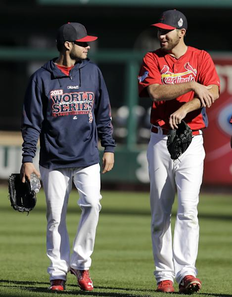 St. Louis Cardinals pitchers Joe Kelly, left, and Michael Wacha talk as they walk in from the bullpen Friday, Oct. 25, 2013, in St. Louis. The Cardinals and Boston Red Sox are set to play Game 3 of the World Series on Saturday in St. Louis. (AP Photo/Jeff Roberson)