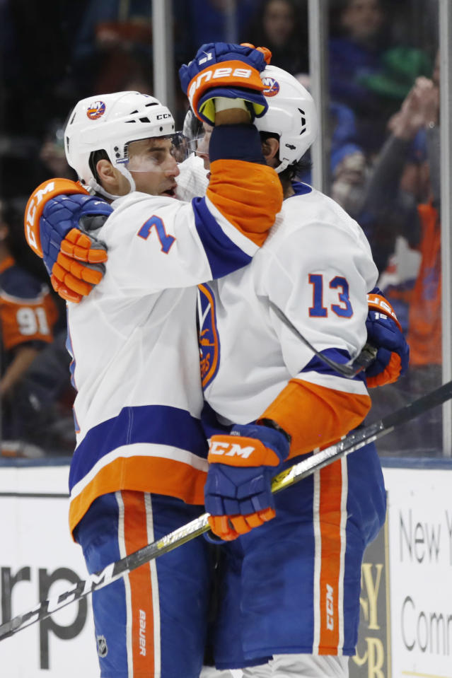 New York Islanders right wing Jordan Eberle (7) celebrates with center Mathew Barzal (13) after Eberle scored his second goal of the night against the Detroit Red Wings, during the second period of an NHL hockey game Friday, Feb. 21, 2020, in Uniondale, N.Y. (AP Photo/Kathy Willens)