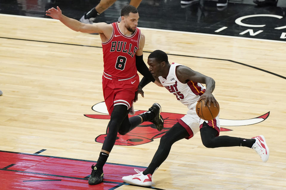Miami Heat guard Kendrick Nunn, right, drives against Chicago Bulls guard Zach LaVine during the first half of an NBA basketball game in Chicago, Friday, March 12, 2021. (AP Photo/Nam Y. Huh)