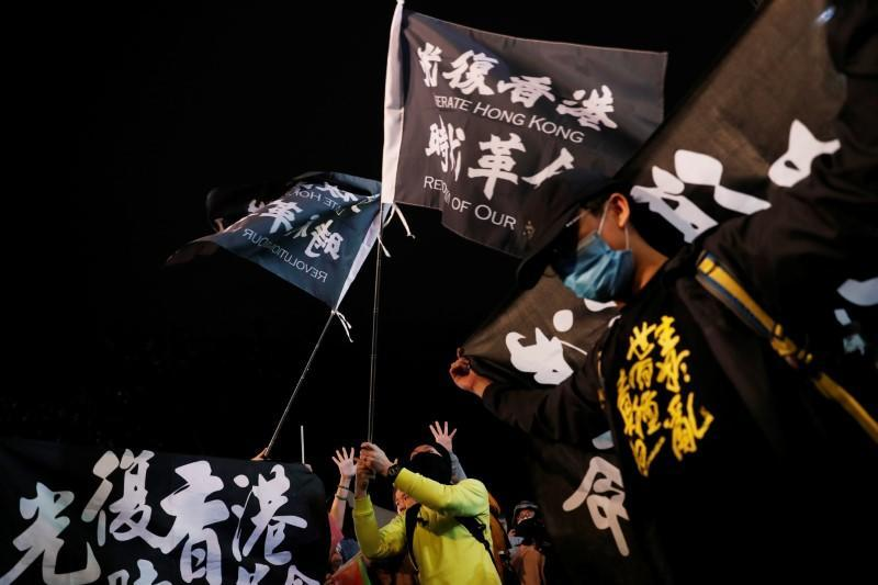 Hong Kong anti-government protesters attend a rally in support of Taiwan President Tsai Ing-wen outside the Democratic Progressive Party (DPP) headquarters in Taipei