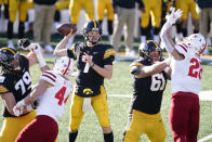 Iowa quarterback Spencer Petras (7) throws a pass during the second half of an NCAA college football game against Nebraska, Friday, Nov. 27, 2020, in Iowa City, Iowa. Iowa won 26-20. (AP Photo/Charlie Neibergall)