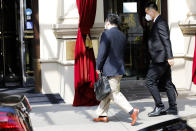 The ambassador of the Permanent Mission of the People's Republic of China to the United Nations, Wang Qun, enters the 'Grand Hotel Wien' where closed-door nuclear talks with Iran take place in Vienna, Austria, Saturday, May 1, 2021. (AP Photo/Lisa Leutner)