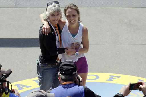 FILE - In this April 18, 2016 file photo, former Boston Marathon women's division winner Joan Benoit Samuelson, left, poses with her daughter Abby Samuelson, of Portland, Ore., who had just completed the 120th Boston Marathon in Boston. The Boston Athletic Association, which organizes the race, said Friday, March 15, 2019, that the two-time champion and Olympic gold medalist will be in the field for the 123rd running of the Boston Marathon on Monday, April 15. (AP Photo/Charles Krupa, File)