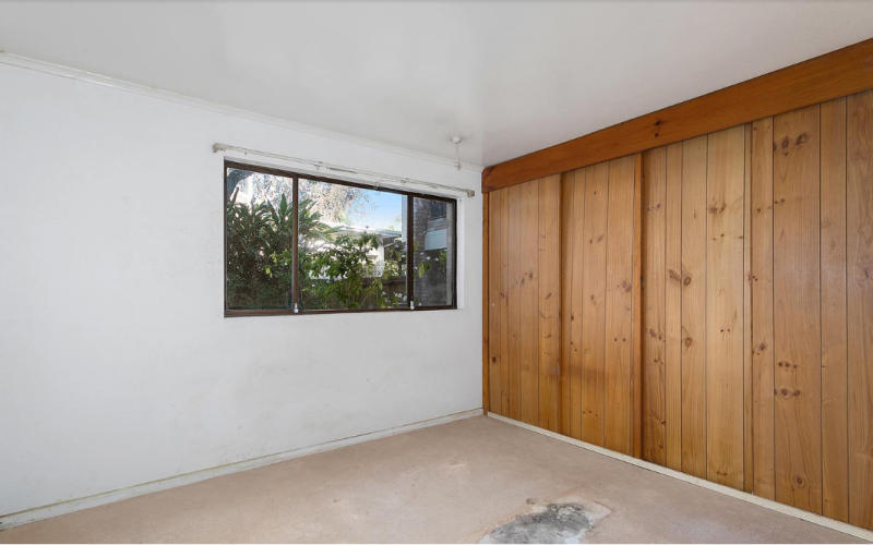 A photo of the master bedroom showing the damage to the floor which was initially altered. The two-bedroom Wollstonecraft apartment in Sydney's lower north shore was put on the market last month, with an asking price of $775,000. Source: Di Jones