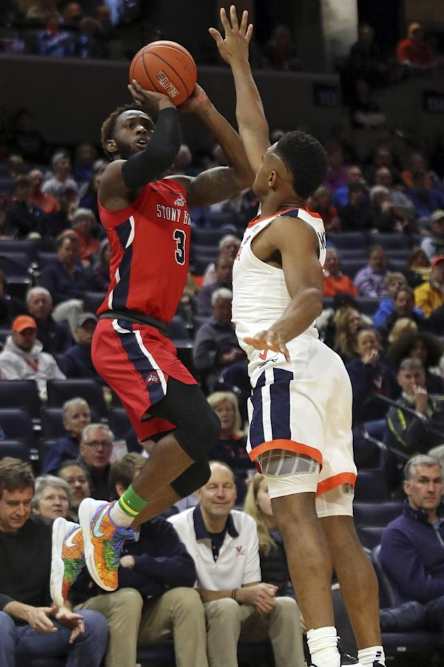 Stony Brook guard Elijah Olaniyi (3) shoots next to Virginia guard Casey Morsell during the first half of an NCAA college basketball game in Charlottesville, Va., Wednesday, Dec. 18, 2019. (AP Photo/Andrew Shurtleff)