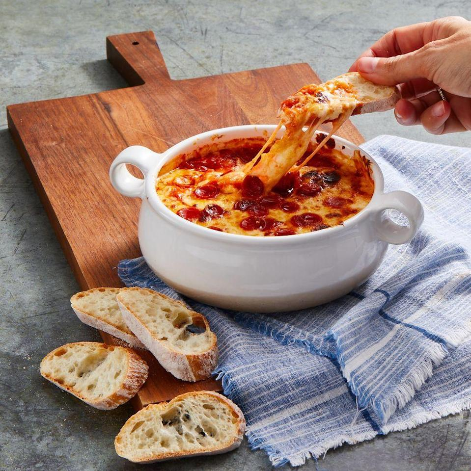 "<p>For a fun take on a classic pie, dip sliced bread into an ooey-gooey dip, made with layers of sour cream, cream cheese, mozzarella, sauce, and pizza spices. </p><p><em><a href=""https://www.goodhousekeeping.com/food-recipes/easy/a34875903/pizza-dip-recipe/"" rel=""nofollow noopener"" target=""_blank"" data-ylk=""slk:Get the recipe for Pizza Dip »"" class=""link rapid-noclick-resp"">Get the recipe for Pizza Dip »</a></em><br></p><p><strong>RELATED:</strong> <a href=""https://www.goodhousekeeping.com/food-recipes/party-ideas/g4967/easy-dip-recipes/"" rel=""nofollow noopener"" target=""_blank"" data-ylk=""slk:Best Dips to Win Over Party Guests"" class=""link rapid-noclick-resp"">Best Dips to Win Over Party Guests </a><br></p>"