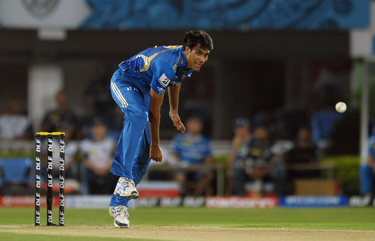 Mumbai Indians  Munaf Patel bowls during the IPL Twenty20 cricket match between Deccan Chargers and Mumbai Indians at Dr. Y.S. Rajasekhara Reddy Cricket Stadium in Visakhapatnam on April 9, 2012. AFP PHOTO / Noah SEELAM.RESTRICTED TO EDITORIAL USE. MOBILE USE WITHIN NEWS PACKAGE. . (Photo credit should read NOAH SEELAM/AFP/Getty Images)