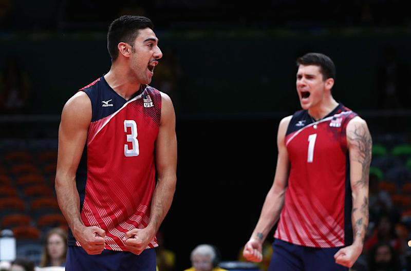 Taylor Sander and Matt Anderson of the U.S. celebrate during the bronze medal match. (Getty)
