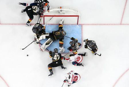 June 7, 2018; Las Vegas, NV, USA; Vegas Golden Knights defenseman Colin Miller (6) helps clear the puck as goaltender Marc-Andre Fleury (29) defends the goal against Washington Capitals center Lars Eller (20) and left wing Andre Burakovsky (65) in game five of the 2018 Stanley Cup Final at T-Mobile Arena. Mandatory Credit: Gary A. Vasquez-USA TODAY Sports