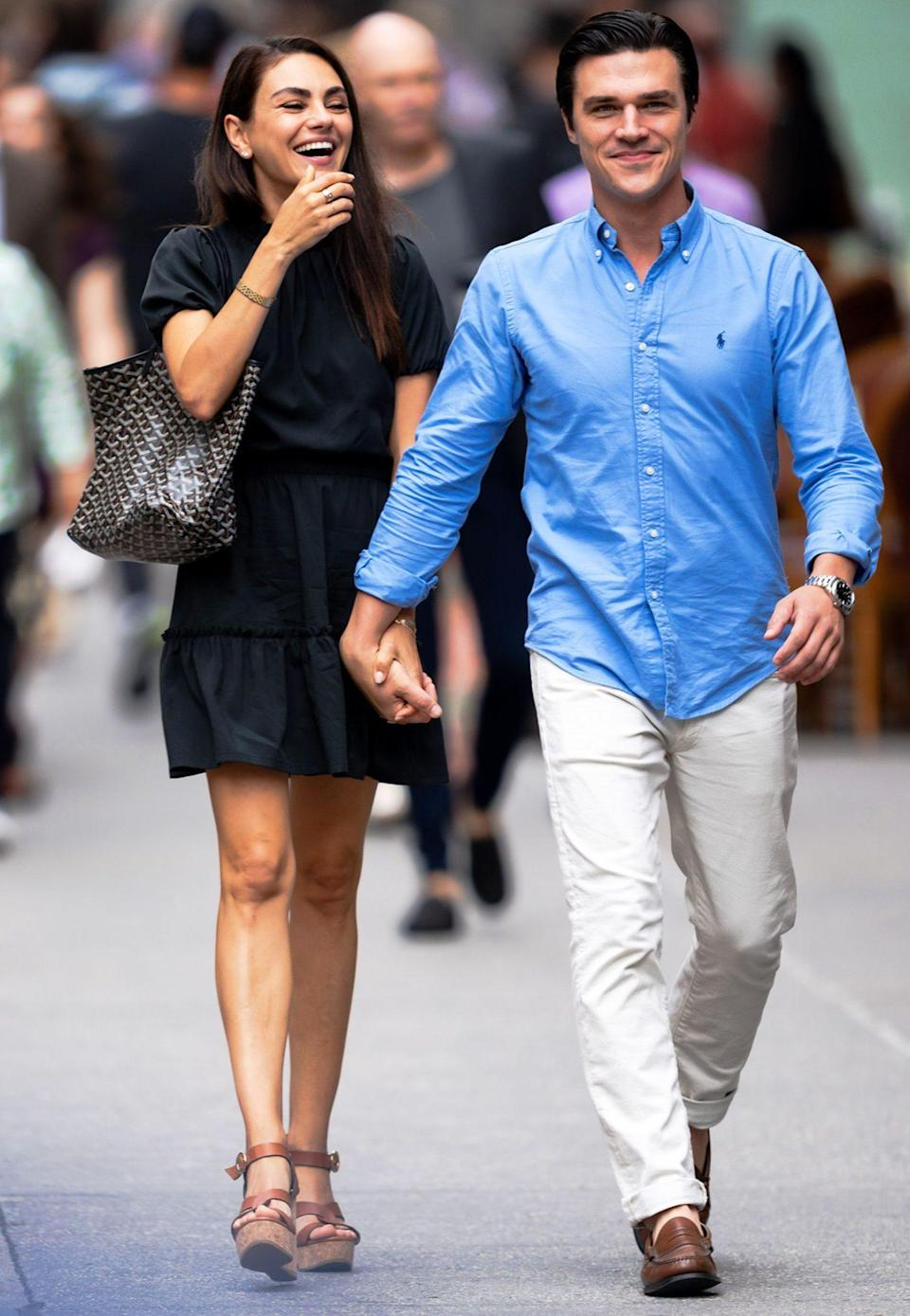 <p>Mila Kunis holds hands with Finn Wittrock while filming <em>Luckiest Girl Alive</em> in N.Y.C. on Aug. 28.</p>