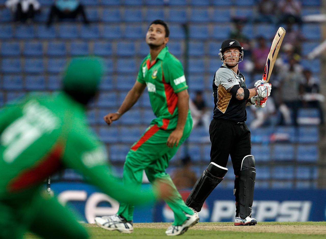 KANDY, SRI LANKA - SEPTEMBER 21:  Brendon McCullum of New Zealand watches the ball after hitting a six from the bowling of Mashrafe Mortaza of Bangladesh during the ICC World T20 Group D match between New Zealand and Bangladesh at Pallekele Cricket Stadium on September 21, 2012 in Kandy, Sri Lanka.  (Photo by Graham Crouch-ICC/ICC via Getty Images)
